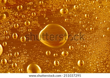 Fresh glass of cold beer with bubbles - stock photo