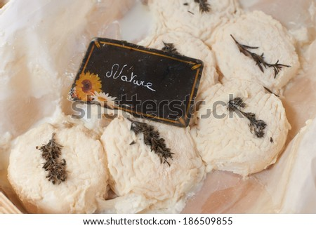 Fresh goat cheese on Provence market of South France, gourmet dairy product - stock photo