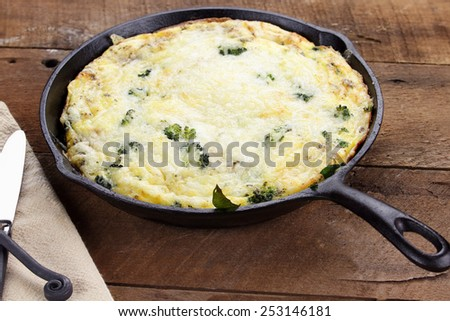 Fresh golden, broccoli, mushroom and spinach frittata with shallow depth of field.