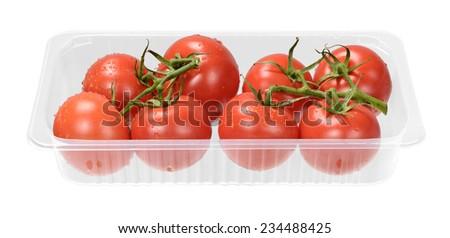 Fresh grape tomatoes in tray - stock photo