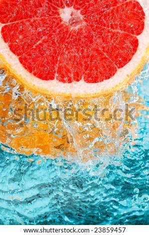 fresh grapefruit in streaming water - stock photo