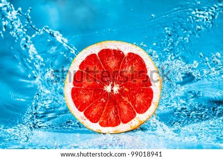 Fresh Grapefruit in Water Splash - stock photo
