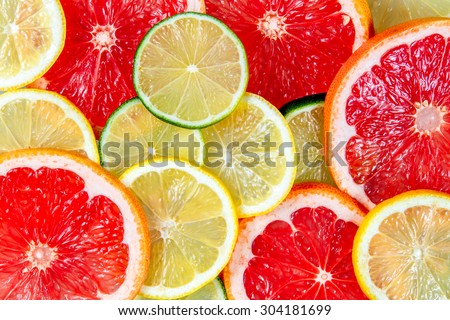 Fresh Grapefruit juicy slices. Rich with vitamin C isolated on white background - stock photo
