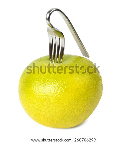 fresh grapefruit with curved fork isolated against white background - stock photo