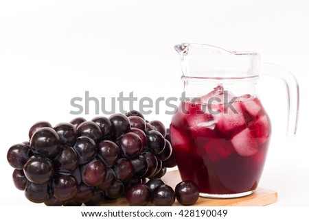 Fresh grapes juice on ice and bunch of grapes isolated on white background