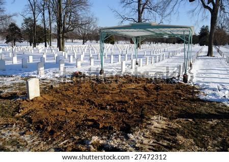 Fresh grave at the Arlington National Cemetery in Virginia - stock photo