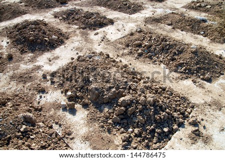 Fresh graves in a cemetery. Concept photo of death, war, crime, murder, kill, killing, and crimes against humanity. - stock photo