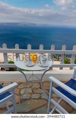 fresh greek breakfast  by seaside with caldera view, Santorini, Greece - stock photo