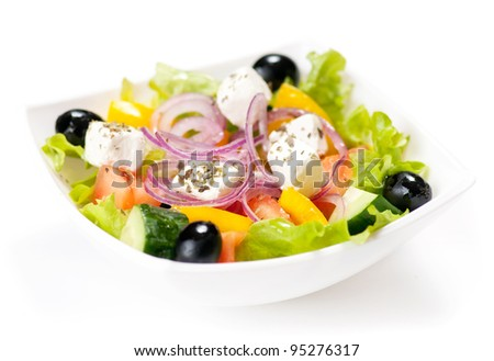 Fresh greek salad on the white background - stock photo