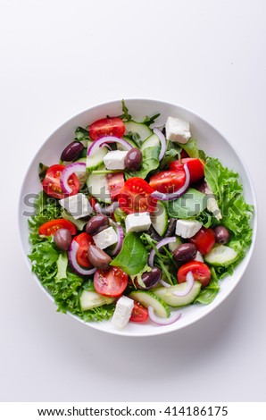 fresh greek salad with  on white background