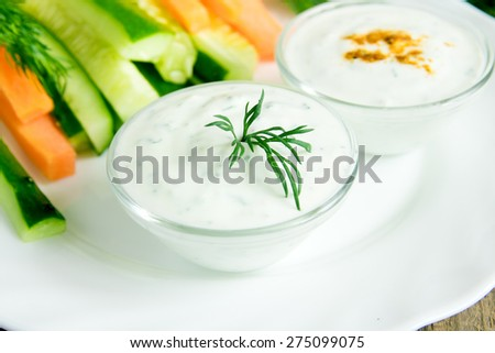 fresh Greek Tzatziki yogurt dip (sauce) and assorted vegetables on white plate