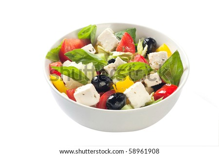 Fresh Greek vegetable salad with feta cheese on a white plate - stock photo