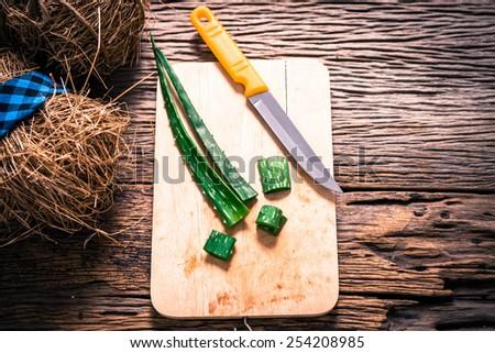 Fresh green aloe leaves on wooden - stock photo