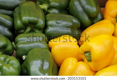 Fresh green and yellow Bell peppers at the greengrocer - stock photo