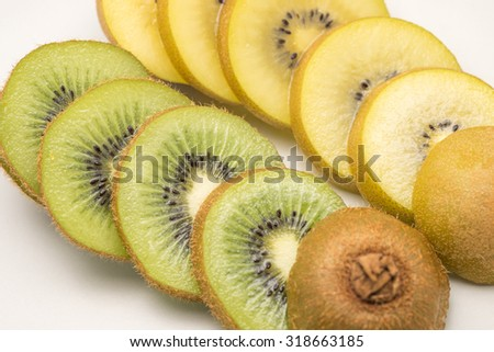 Fresh green and yellow sliced kiwi fruit for a healthy diet background with selective focused point - stock photo