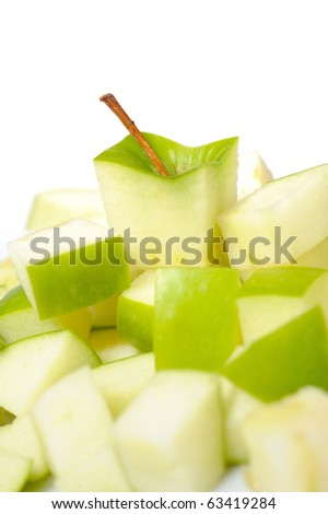 fresh green apple cut into slices. isolated on white background - stock photo