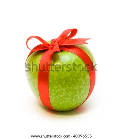 Fresh green apple packaging in red tape - stock photo