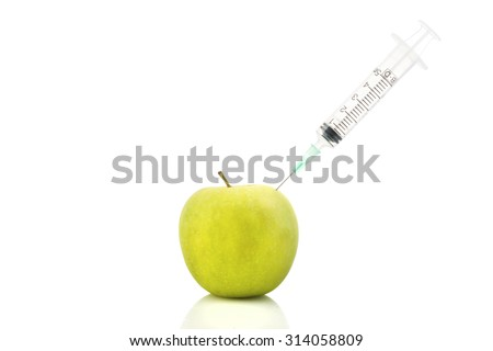 Fresh green apple with a syringe inject on it isolated white background - concept for genetically modified foods for diet and future health concept. - stock photo
