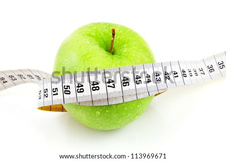 Fresh green apple with measure tape over white background