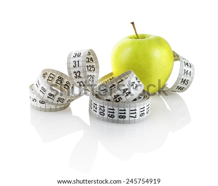Fresh green apple with measuring tape on white background. Isolated with clipping path.