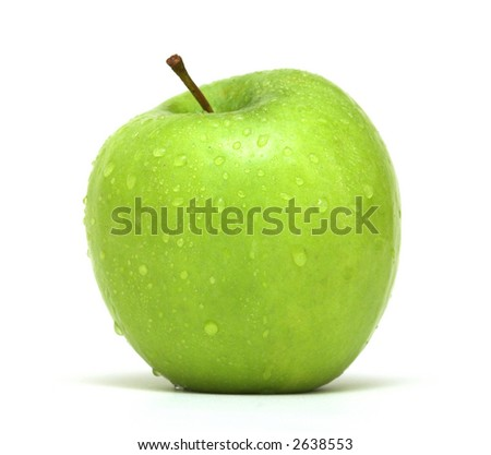 Fresh Green Apple with water droplets against a white background - stock photo