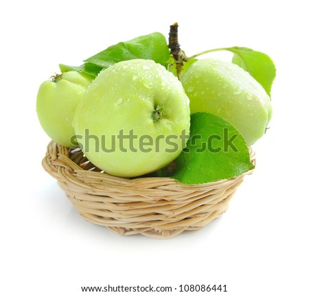 Fresh green apples are in a little basket on a white background - stock photo