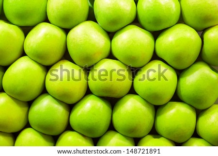 Fresh green apples in a row