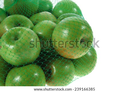 fresh green apples in green transport net ready to sell isolated on white background