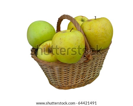 Fresh green apples in wicker basket isolated over white background - stock photo