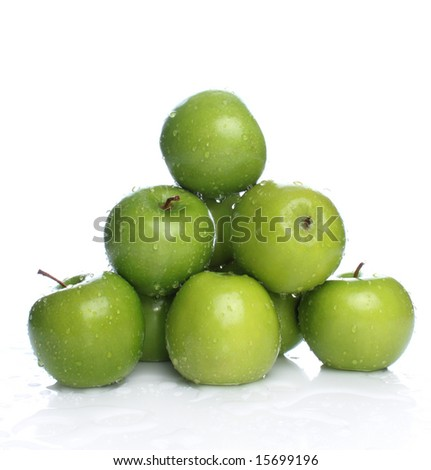 Fresh green apples with drops of water