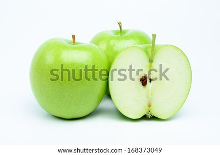 Fresh green apples with half on white background - stock photo