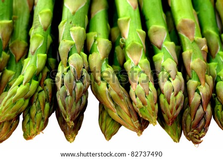 Fresh green asparagus tips isolated on white - stock photo