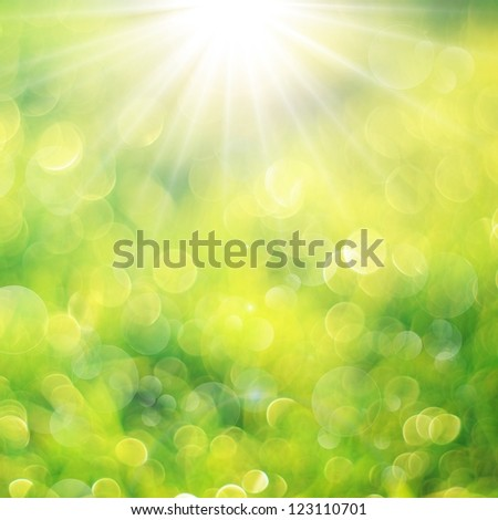 Fresh green background with bokeh bubbles and sun light. Spring or summer background - stock photo