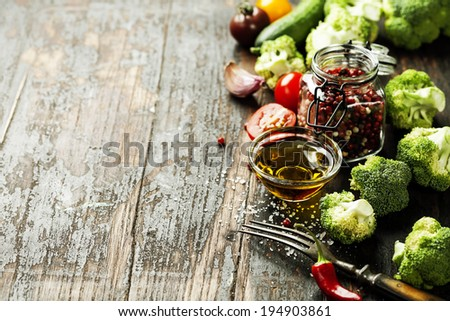 Fresh green broccoli and Healthy Organic Vegetables on a Wooden Background. - stock photo