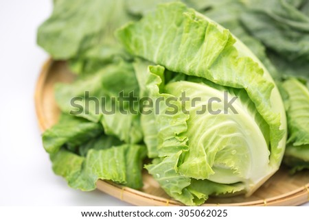 Fresh green Brussel sprout on for food ingredient on bamboo basket with white background - stock photo