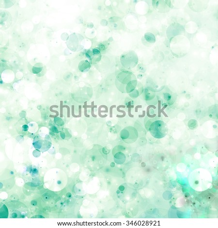 Fresh green bubbles background with abstract defocused lime color bubbles and light green tones