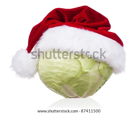 Fresh green cabbage vegetable with Santa hat on white background - stock photo