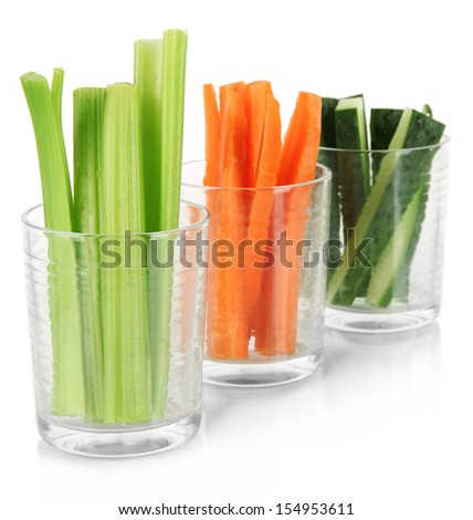 Fresh green celery with vegetables in glasses isolated on white - stock photo