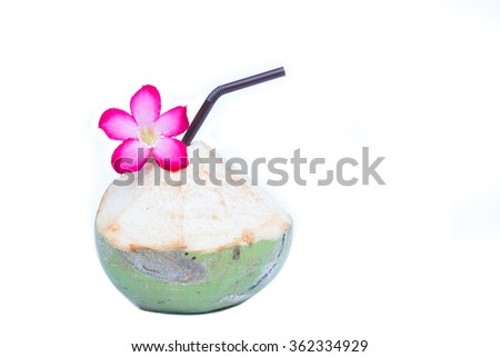 Fresh Green coconuts with drinking straw and flower isolated on white background - stock photo