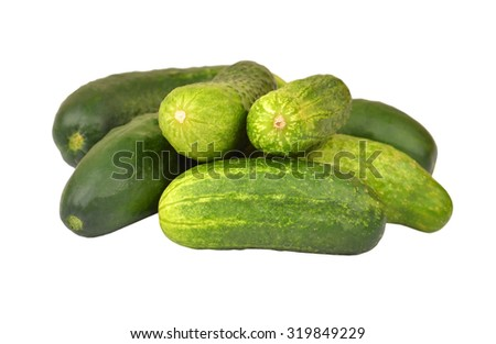 Fresh green cucumber gherkin, isolated on a white, DOF - stock photo