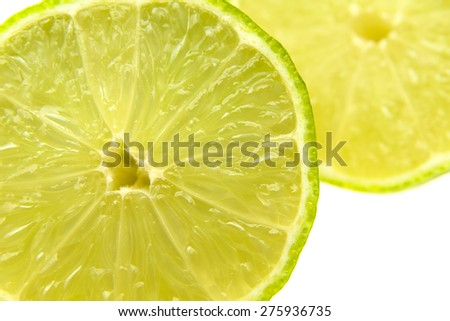 fresh green cut lime fruit  isolated on white background - stock photo