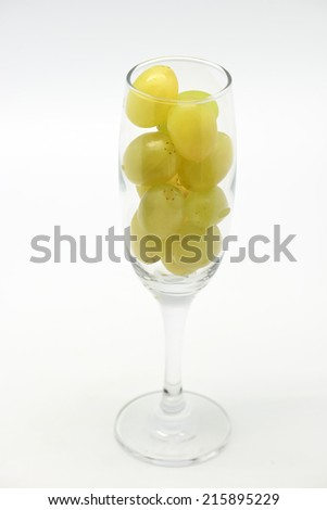 Fresh green grapes in glass for new year celebration  on white background - stock photo