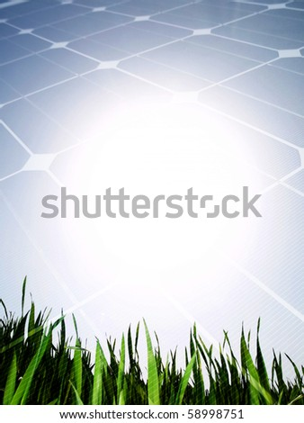 Fresh green grass field against the sun with solar panel - stock photo