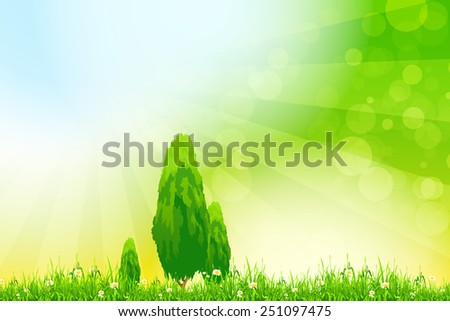 Fresh green grass with yellow bokeh and Trees and flowers. Beauty natural background - stock photo