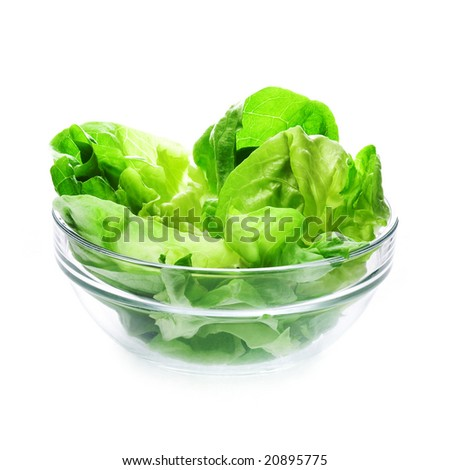 Fresh green lettuce in glass bowl, clipping path