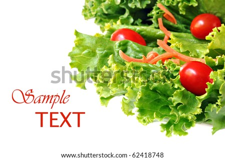 Fresh green lettuce salad with shredded carrots and grape tomatoes on white background with copy space.  Macro with shallow dof. - stock photo