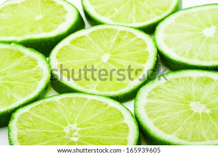 Fresh green lime isolated on white background - stock photo