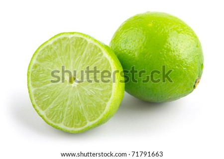 fresh green limes on a white background - stock photo
