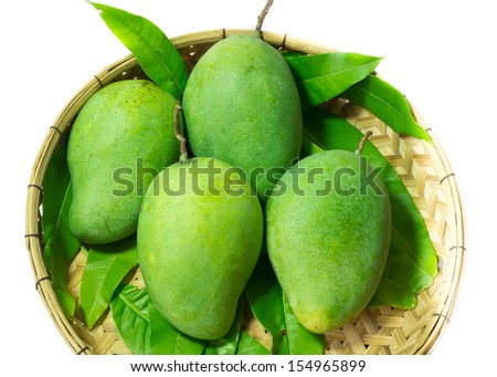 Fresh green mango in basket  - stock photo