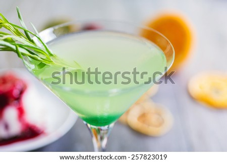 fresh green mint soft lemonade in a glass on a wooden table with decorations focus on different parts of the glass - stock photo